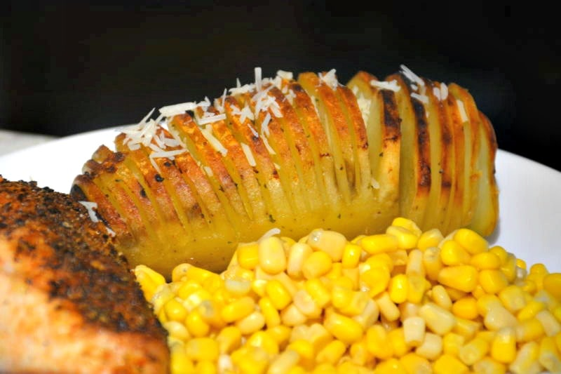 Swedish potatoes with corn on white plate makes the list of easy ham side dishes