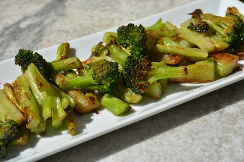 Skillet roasted broccoli on white tray. One of the best side dishes for ham.