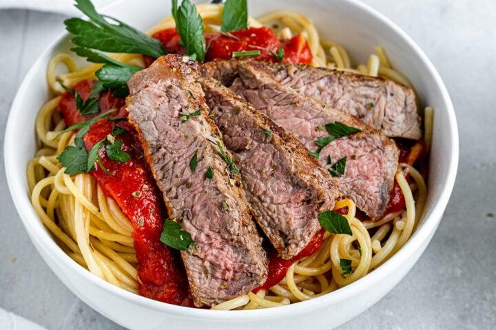 a bowl of steak and spaghetti recipe