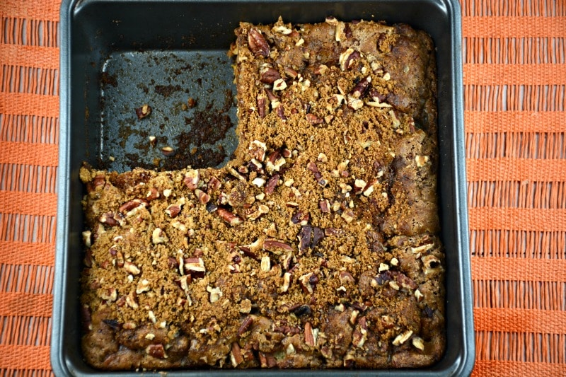 Overhead shot of dump cake in baking dish with slice removed.