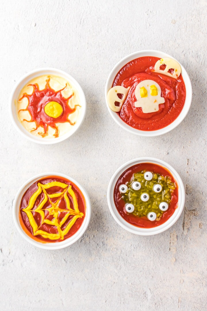 Overhead shot of four different dipping sauces in bowls