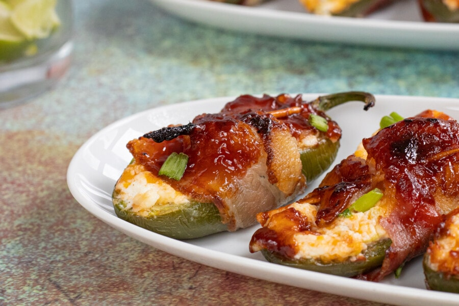 Close up photo of Bacon Wrapped Cream Cheese Stuffed Jalapeno Poppers