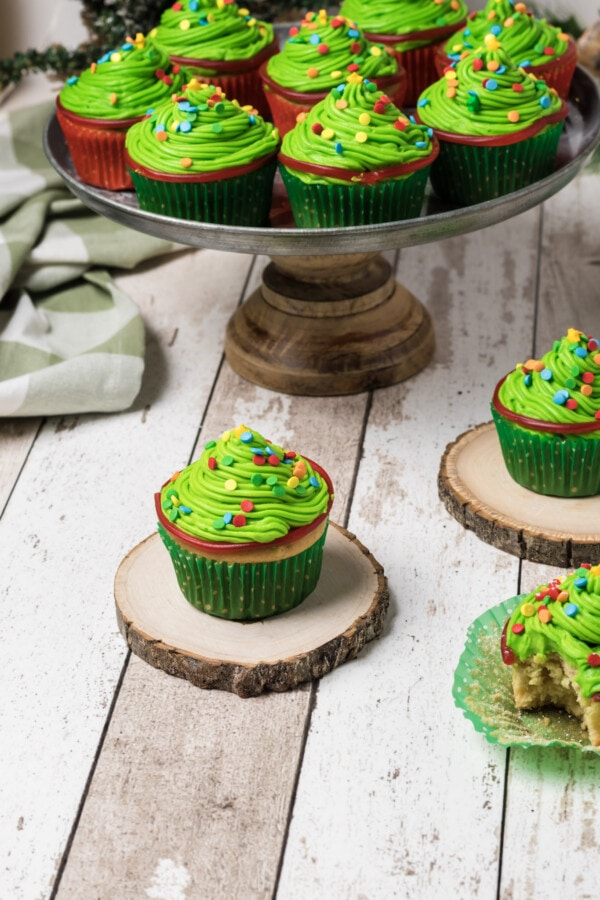 A beautifully styled shot of festive-looking Christmas tree cupcakes.