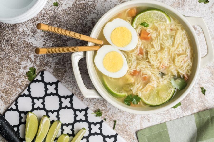 Overhead shot of ramen with chopsticks in pot