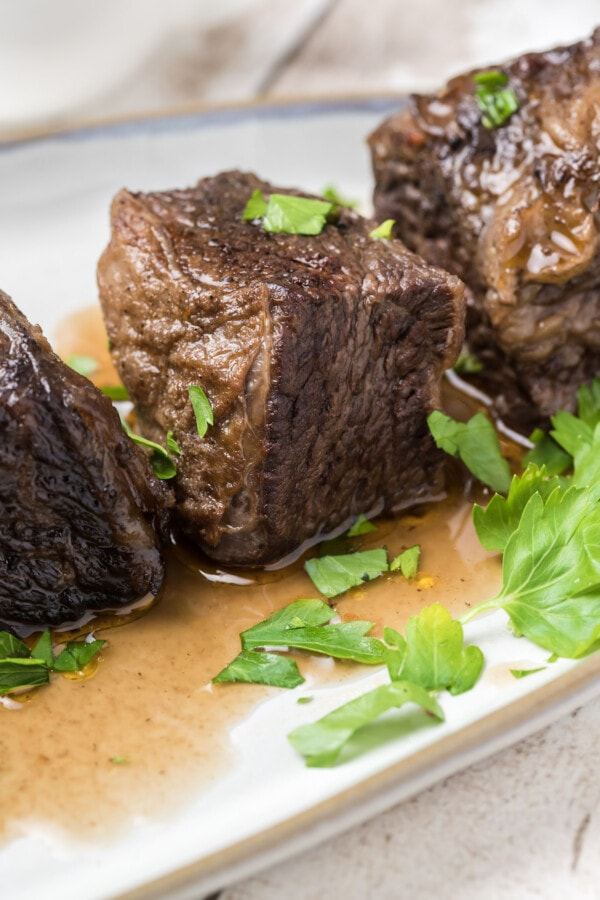 Closeup shot of Instant Pot beef short ribs on white plate