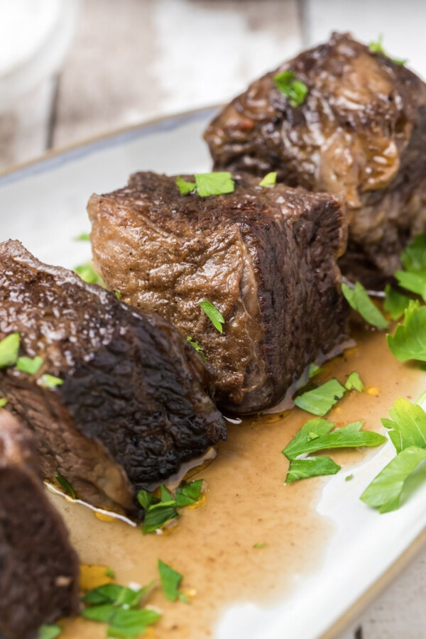 Instant pot beef short ribs on white plate