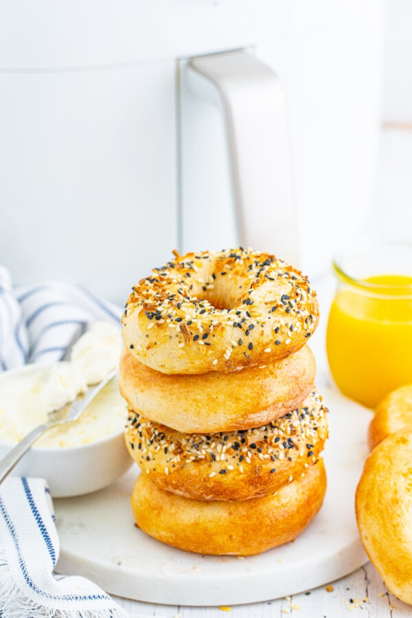 bagel in air fryer stacked up - plain and everything flavor