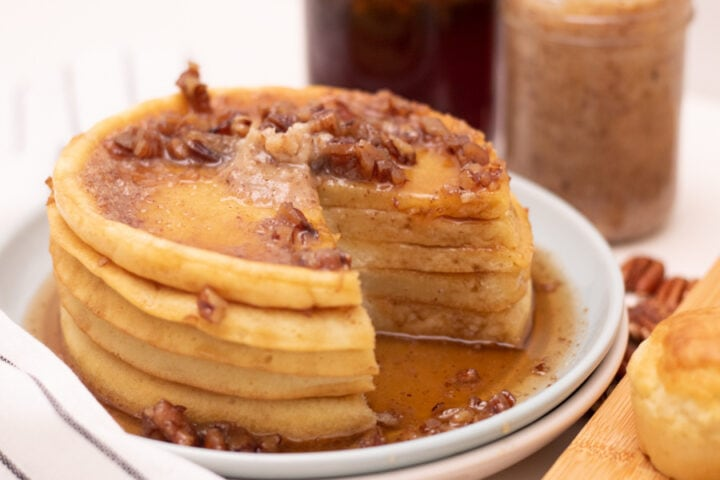 stack of homemade flapjacks with syrup and nuts on it