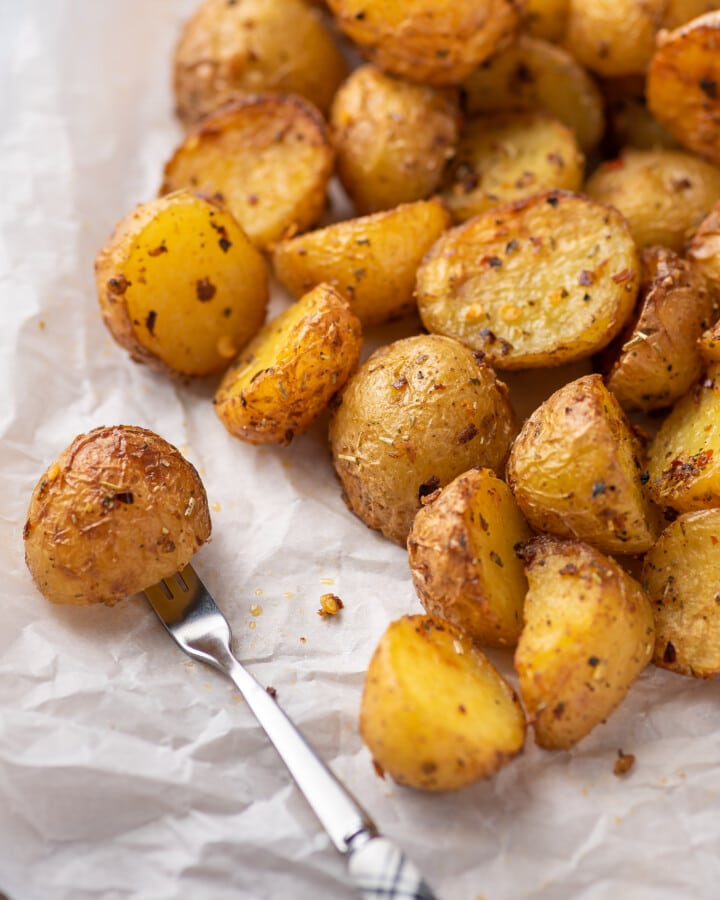 a close-up photograph of cooked mini potatoes