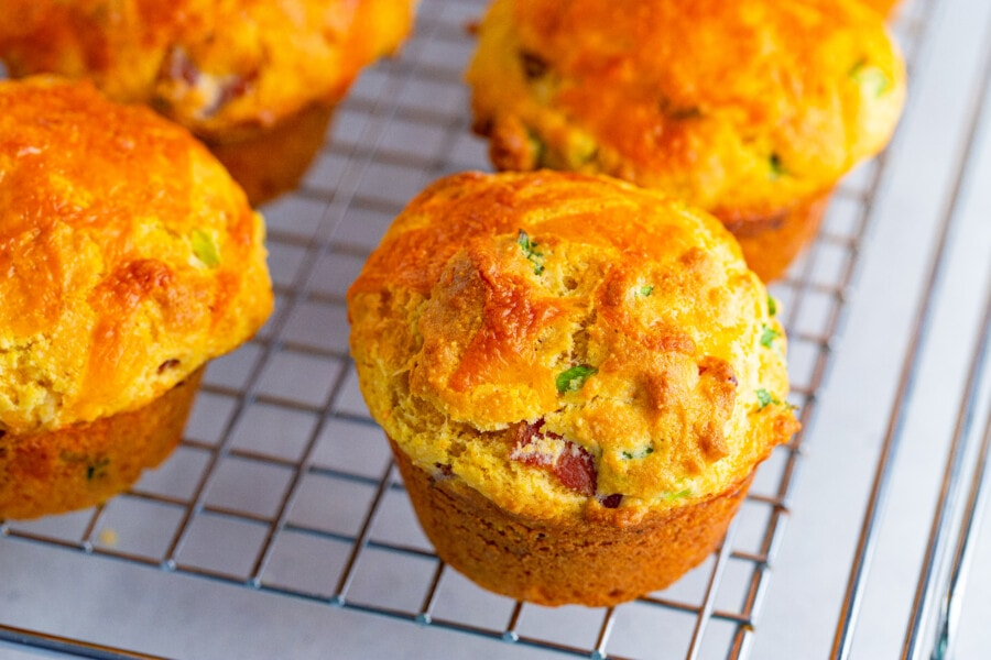 a close up of best corn muffin recipe all on a rack cooling.