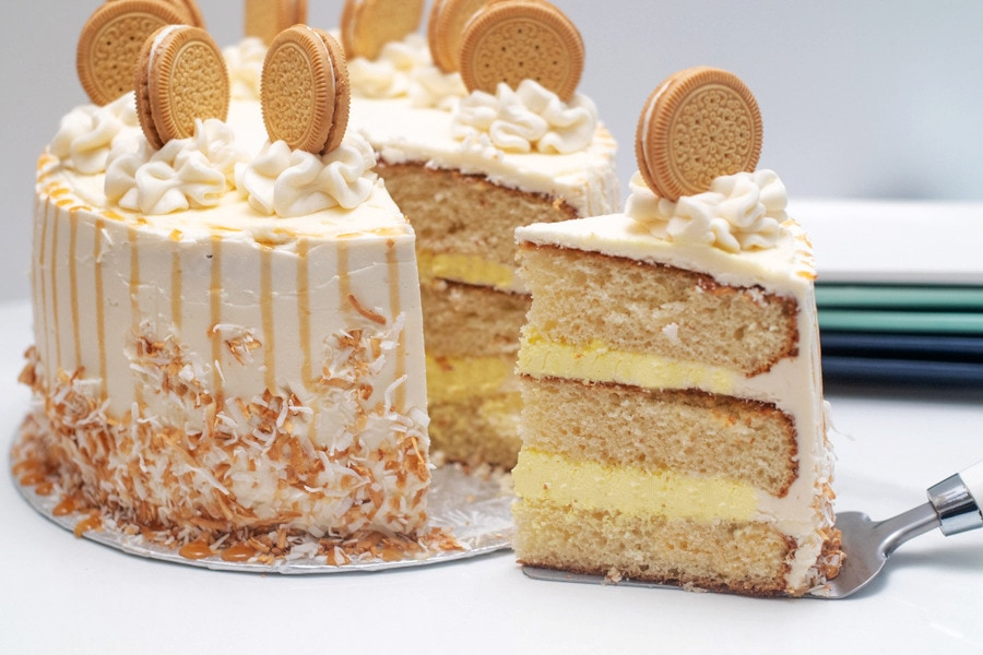 Banan pudding layered cake with slice being removed