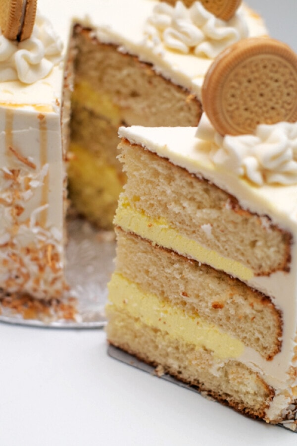 Closeup shot of layer cake with slice being removed.