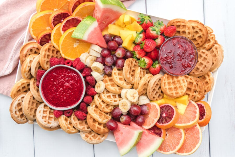 An entire waffle board filled with waffles, fresh fruit and raspberry and strawberry sauces. You'll love your brunch charcuterie board