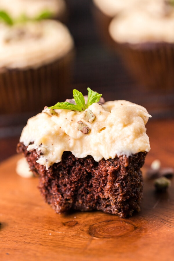 Closeup shot of chocolate mint cupcakes with Bailey's Irish Buttercream frosting with bite taken out