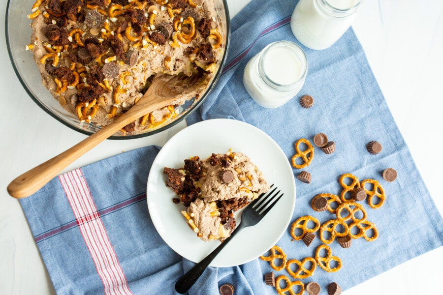bowl and plate of chocolate peanut butter trifle with blue napkin background