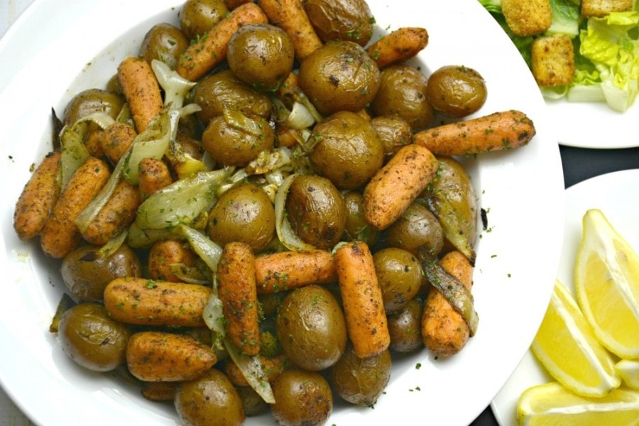 Oven Roasted Carrots and Potatoes on white plate. One of the best side dishes for ham.