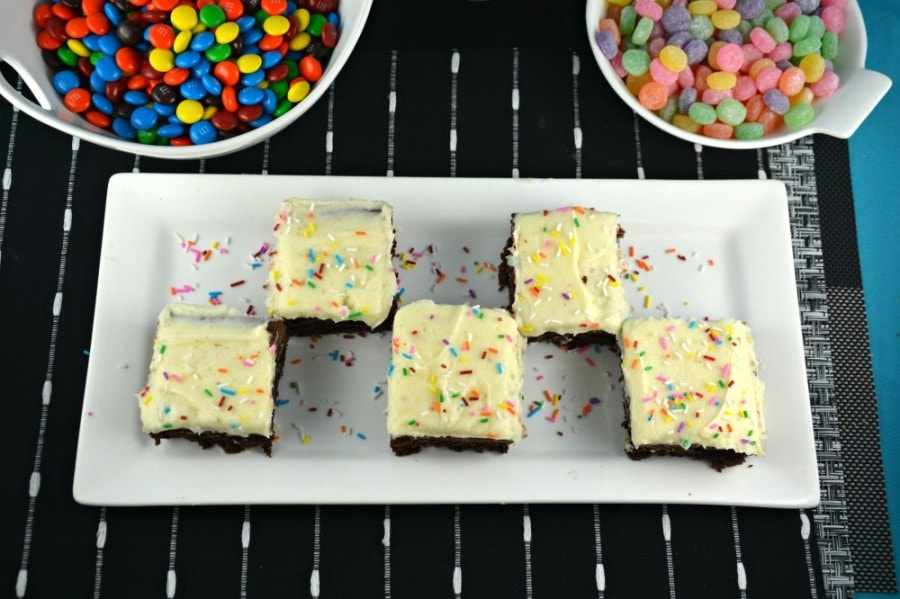 Overhead shot of Peanut Butter Nutella Flavored Brownies cut into squares on a white plate.