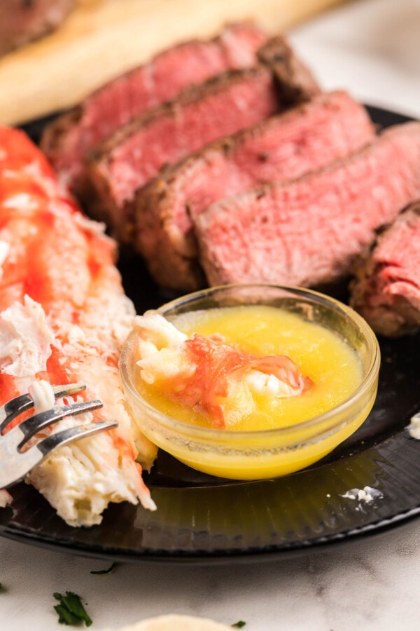 a beautiful spread of black and blue steak and crab with melted butter for dipping