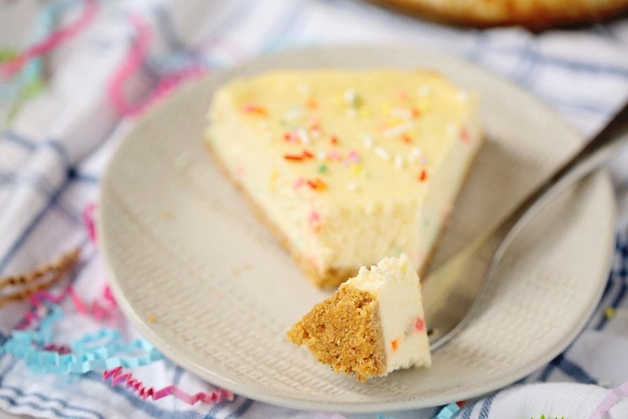 A closeup piece of cheesecake recipe no sour cream on a fork.