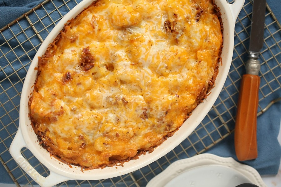 this recipe in casserole dish sitting on a cooling rack with a knife sitting to the right-hand side