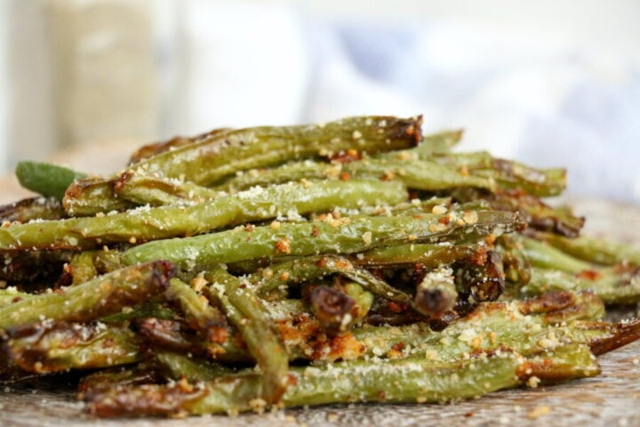 Air Fryer Green beans coated in parmesan cheese on a counter top.
