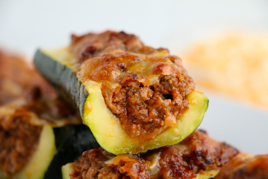 Closeup shot of stuffed zucchini boats stacked atop one another