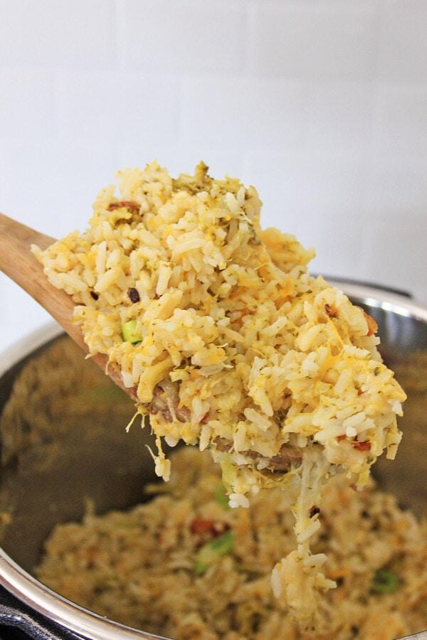 Closeup shot of Instant Pot cheesy broccoli rice on spoon