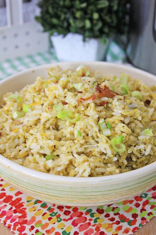 Closeup shot of Instant Pot cheesy broccoli rice in white bowl