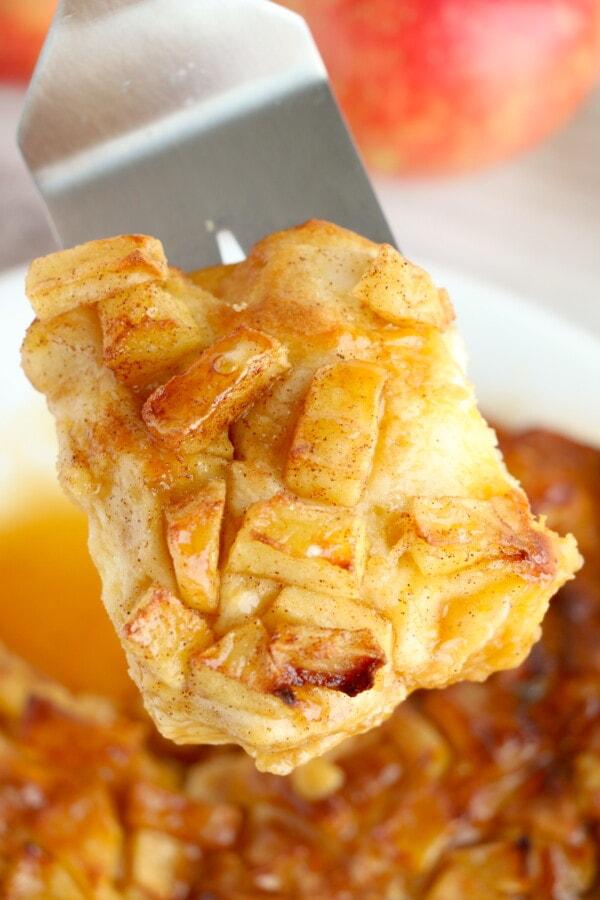 Closeup shot of air fryer danish on spatulat with more air fried danish below