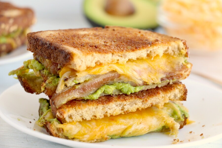 Two slices of air fryer grilled cheese sandwich on white plate