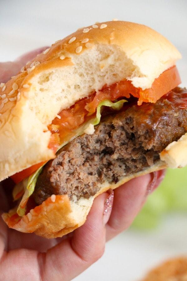 Closeup shot of air fryer hamburger with bite taken out