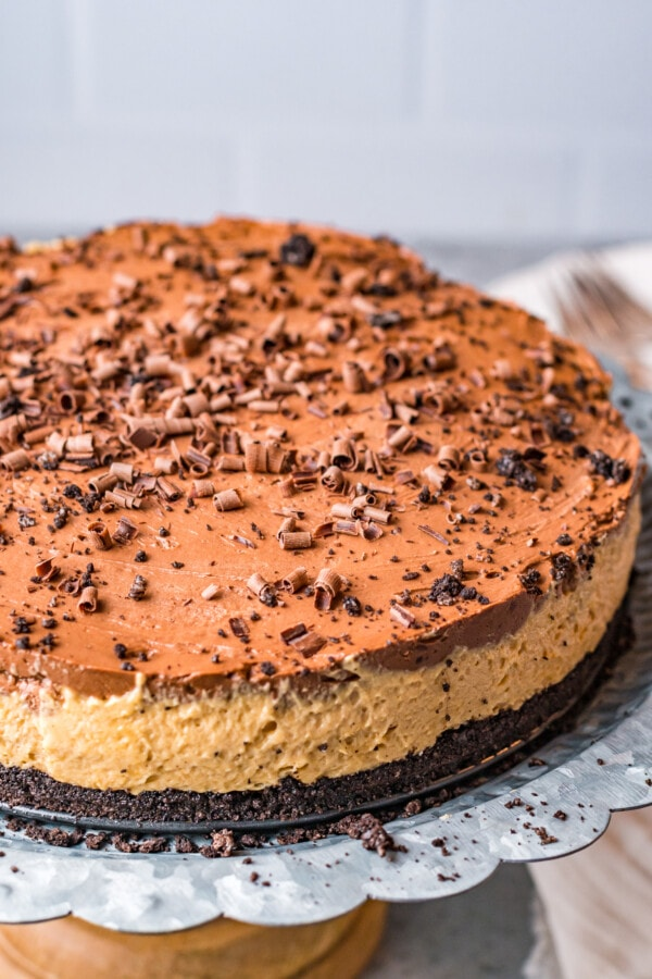 Chocolate peanut butter pie on cake stand