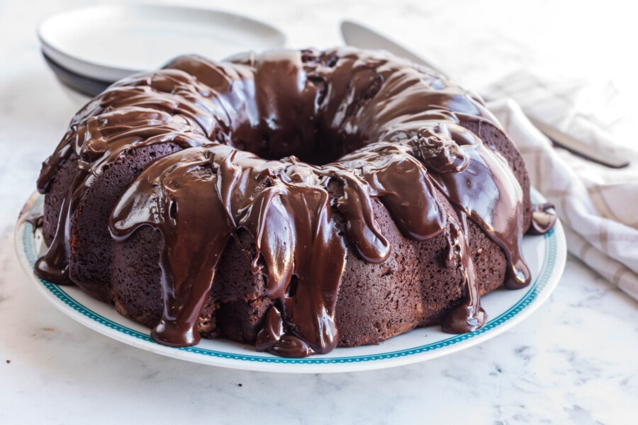 Perfectly baked and decorated chocolate Bundt cake with chocolate glaze for Bundt cake drizzled overtop