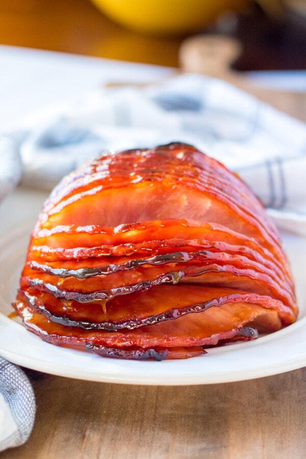 Spiral sliced maple mustard ham on white plate