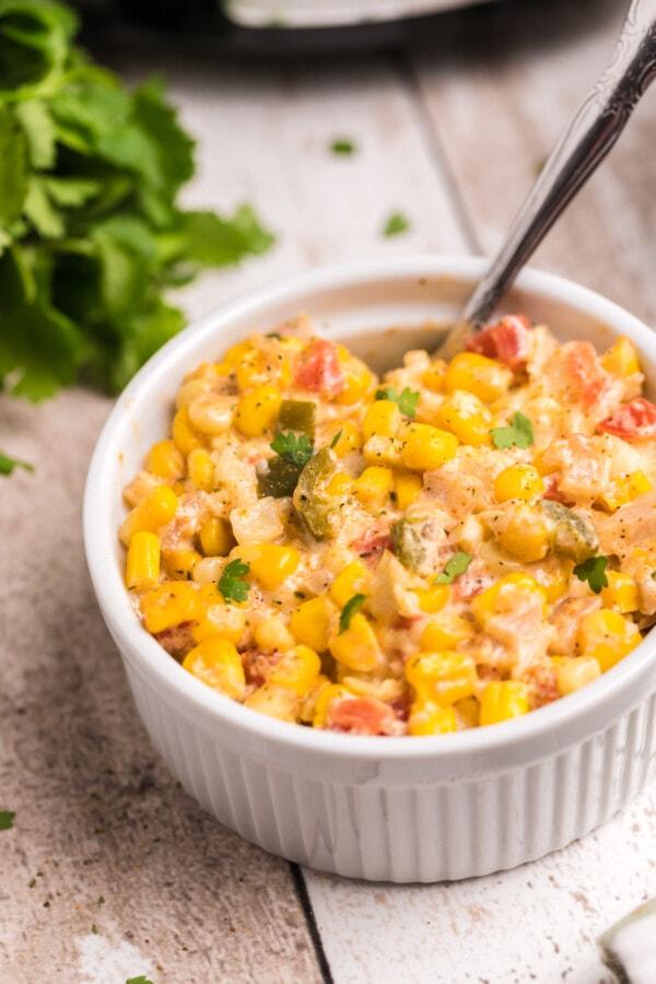 Closeup shot of Mexican street corn casserole in white bowl