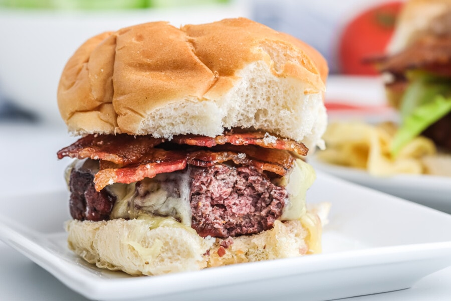 Closeup shot of hamburger with easy smoked bacon slices with bite taken out