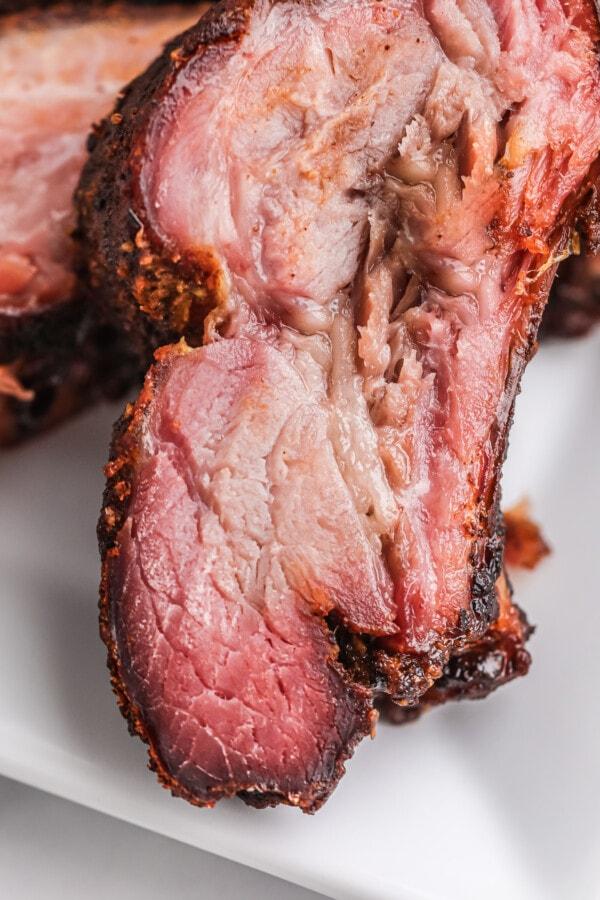 Closeup shot of smoked ribs on white plate