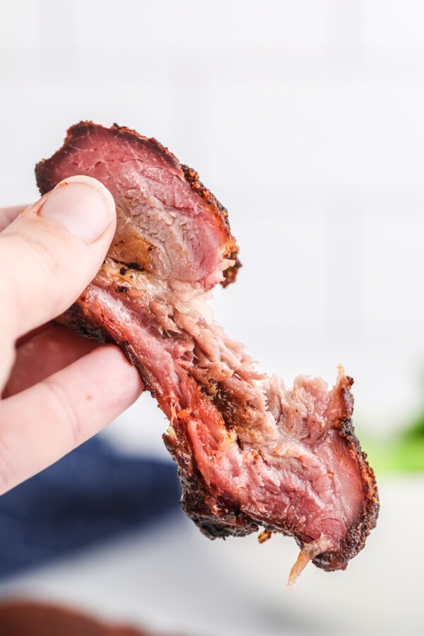 Closeup shot of smoked rib with bite taken out
