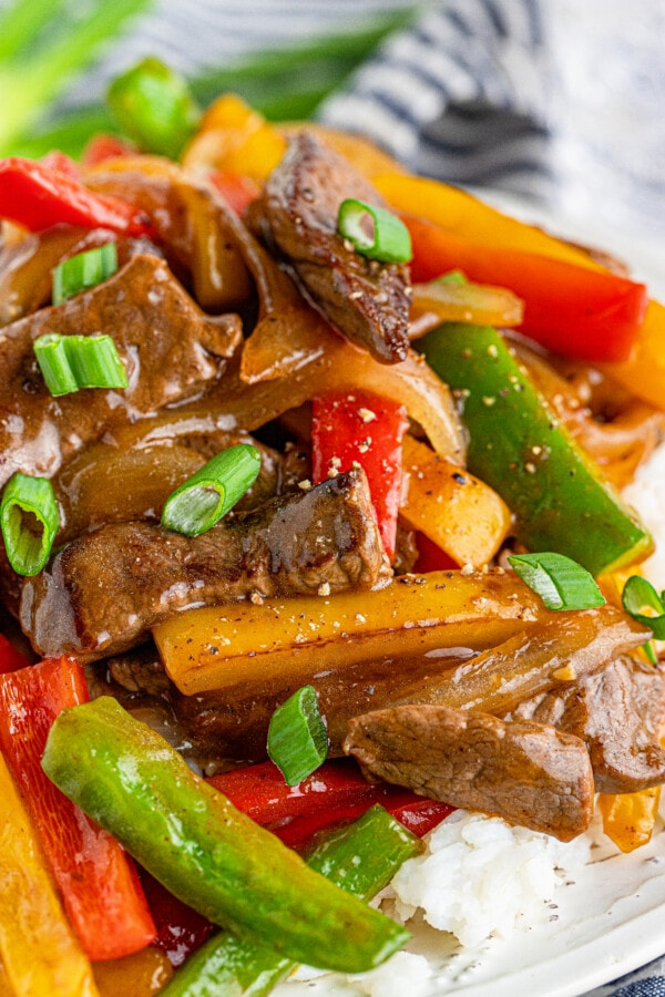 Closeup shot of simple steak and peppers stir fry over rice