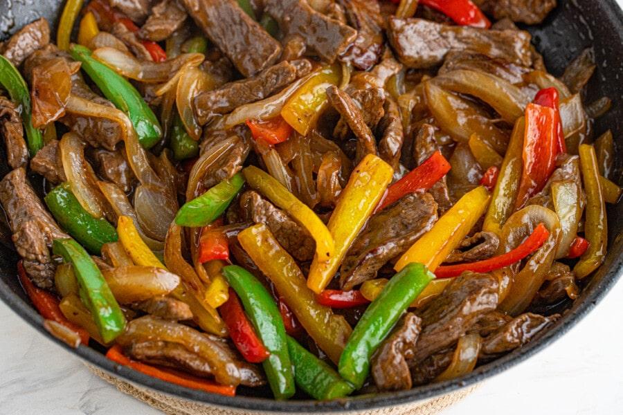 Closeup shot of steak and pepper stir fry in skillet