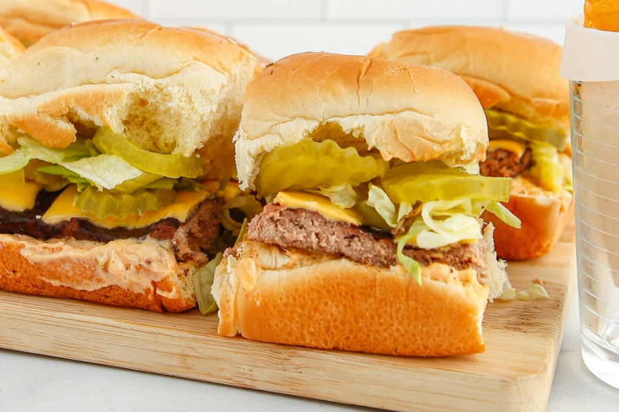 a bamboo platter filled with Big Mac sliders