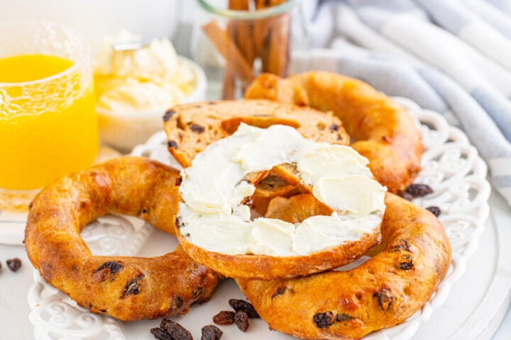 Air Fryer Cinnamon Raisin Bagels on a white lace style plate